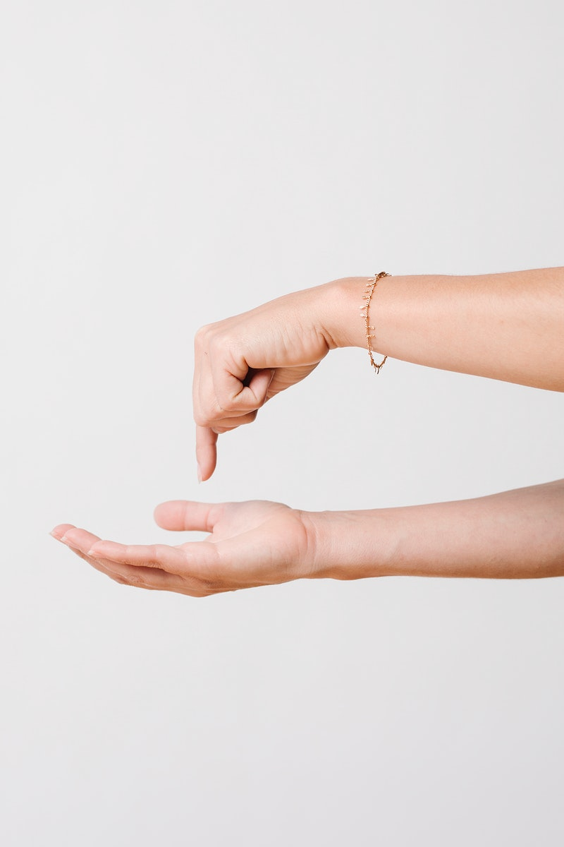 Woman pressing her finger to her own palm