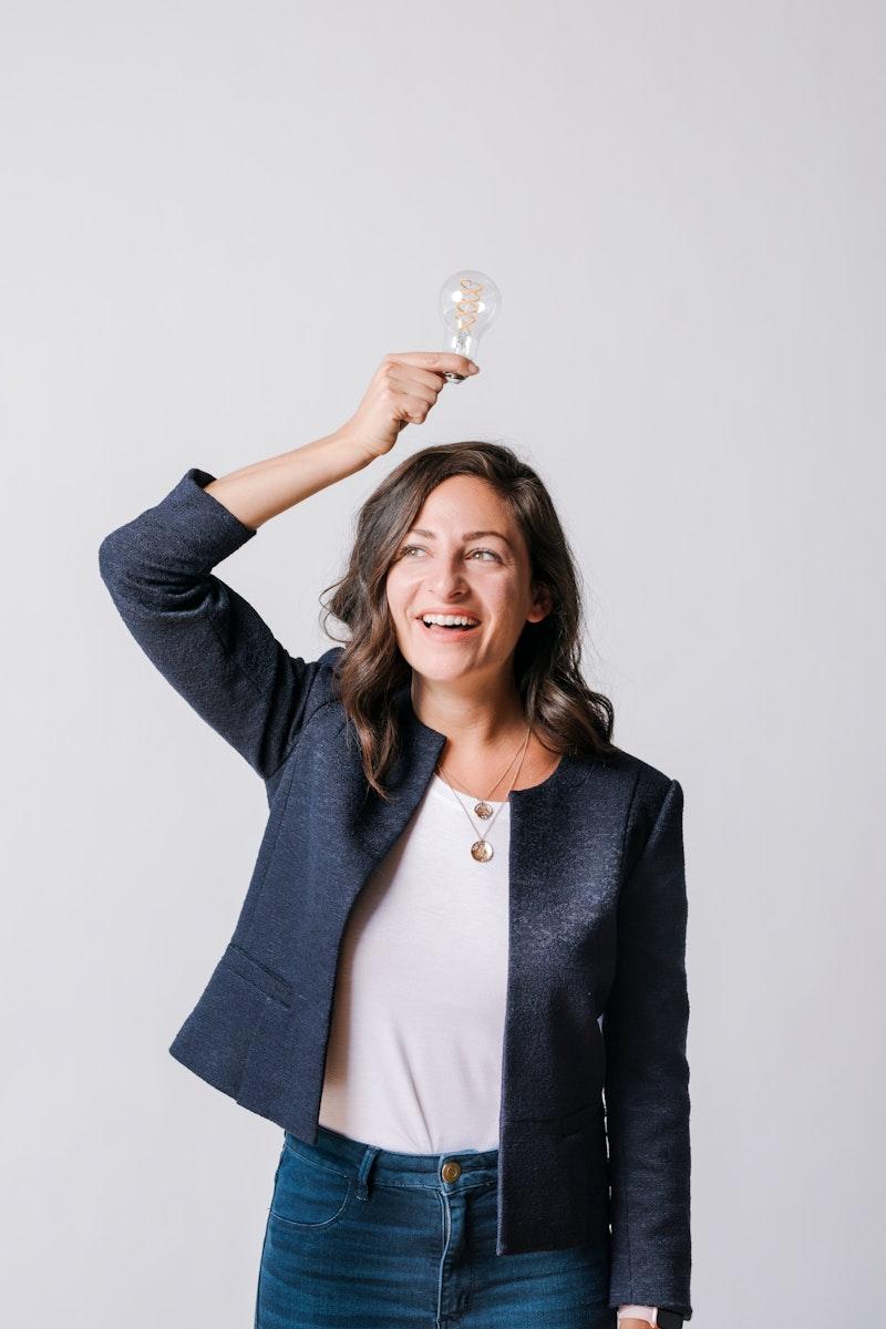 Woman holding a light bulb