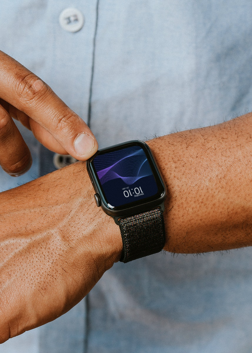 Man in a blue shirt using his smartwatch mockup