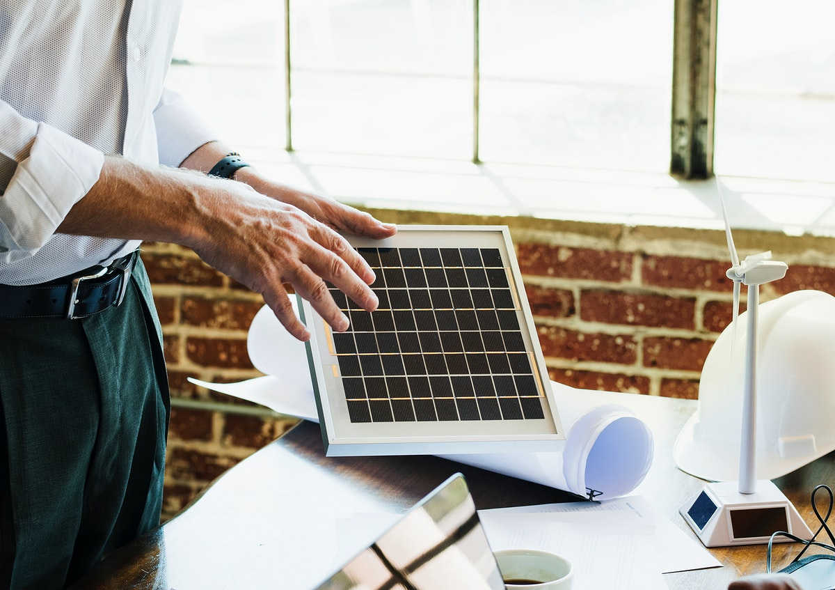 Eco-friendly engineer presenting a solar panel project