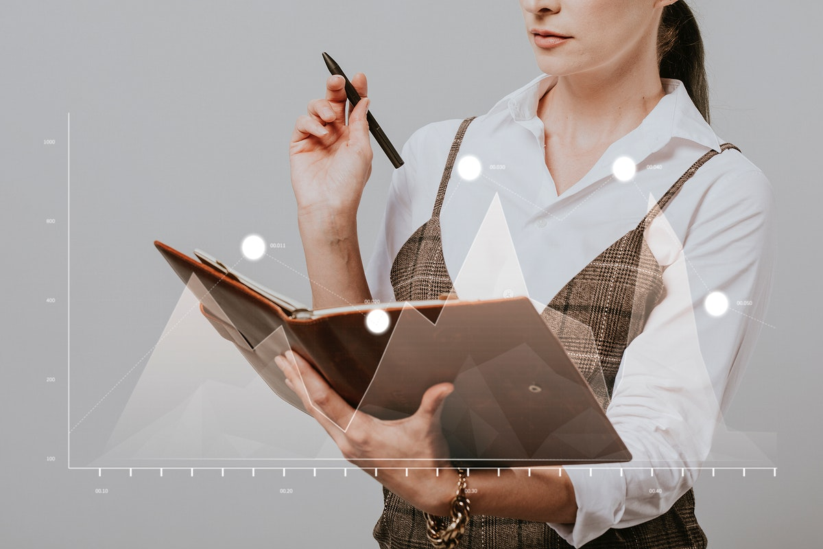 Businesswoman holding a personal notebook and a pen