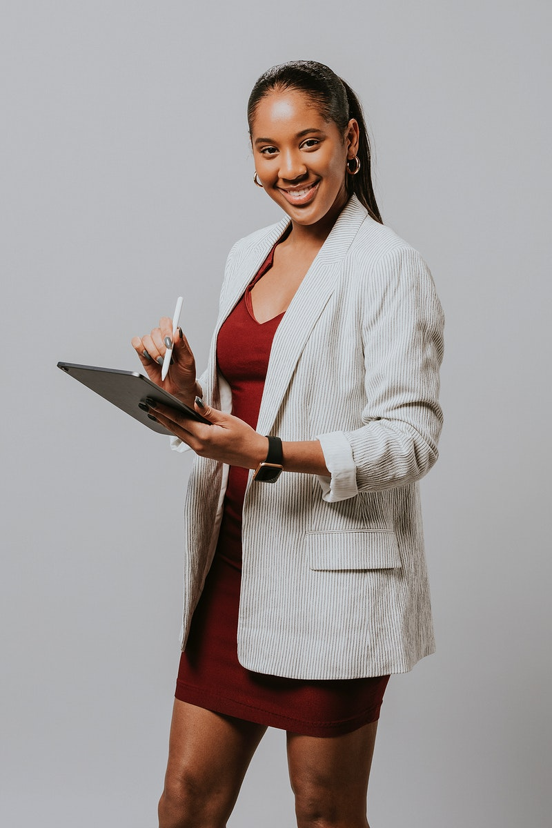 Businesswoman writing on on a tablet