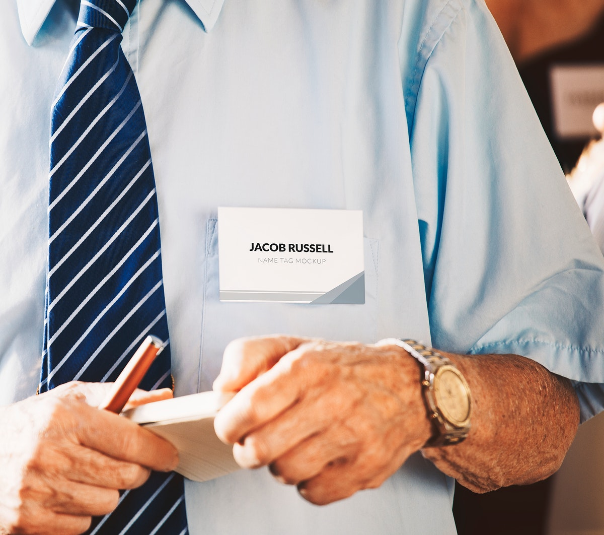 Businessman in a meeting holding a notebook and pen