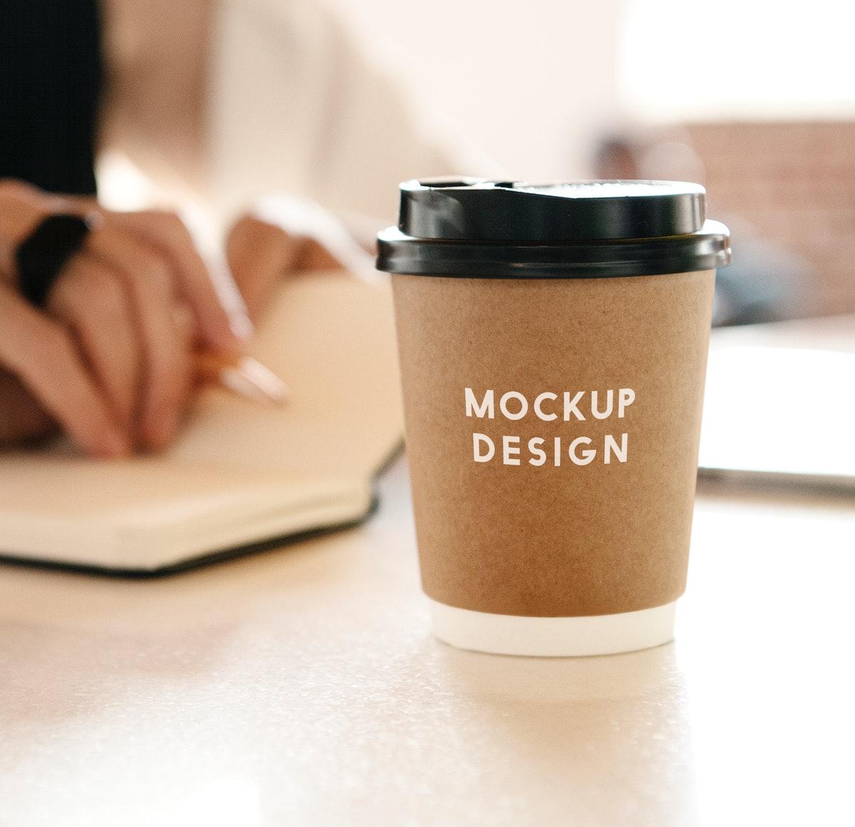 Takeaway coffee cup with black plastic lid mockup