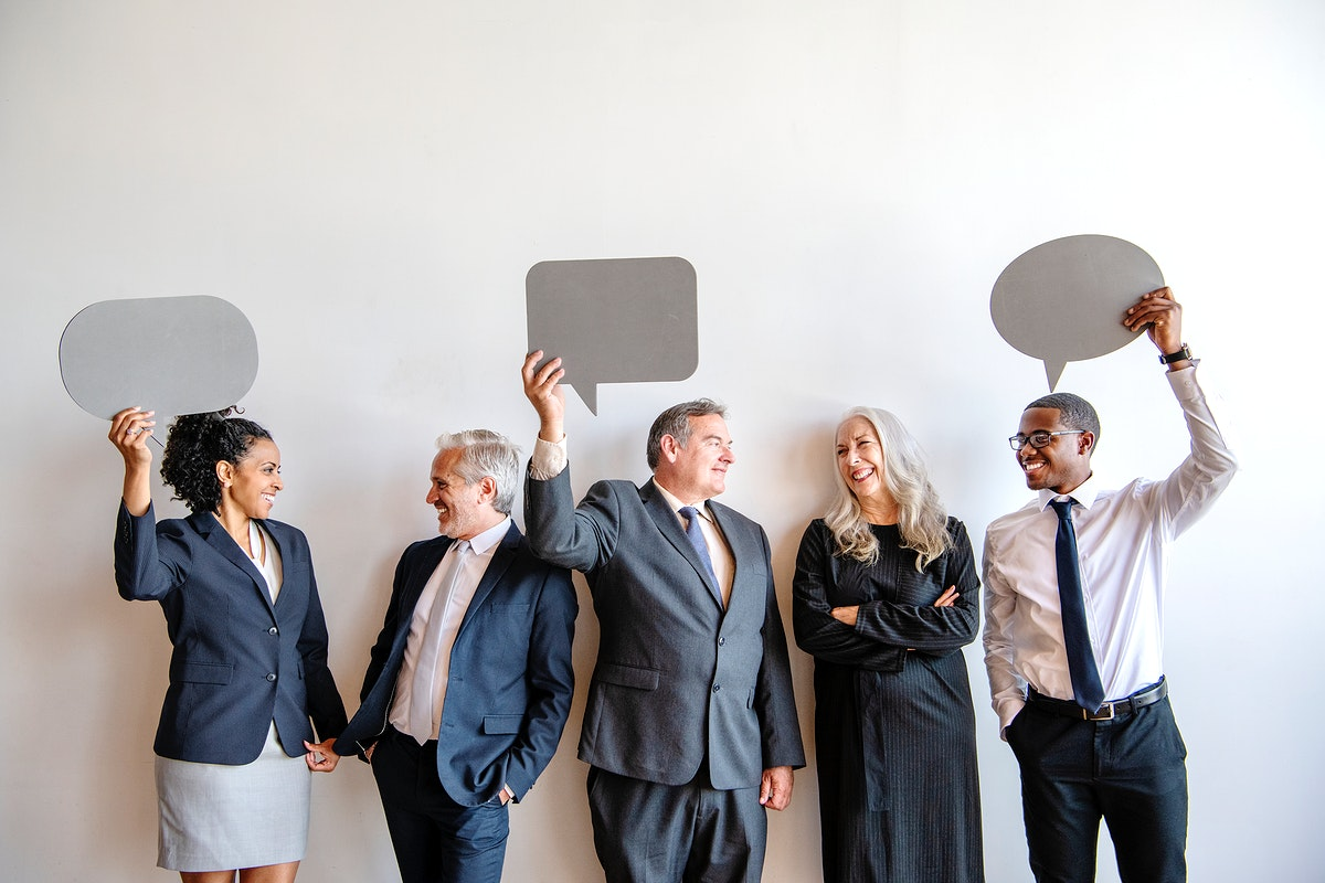Business people with blank speech bubbles