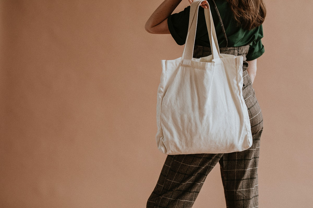 Woman with a beige tote bag