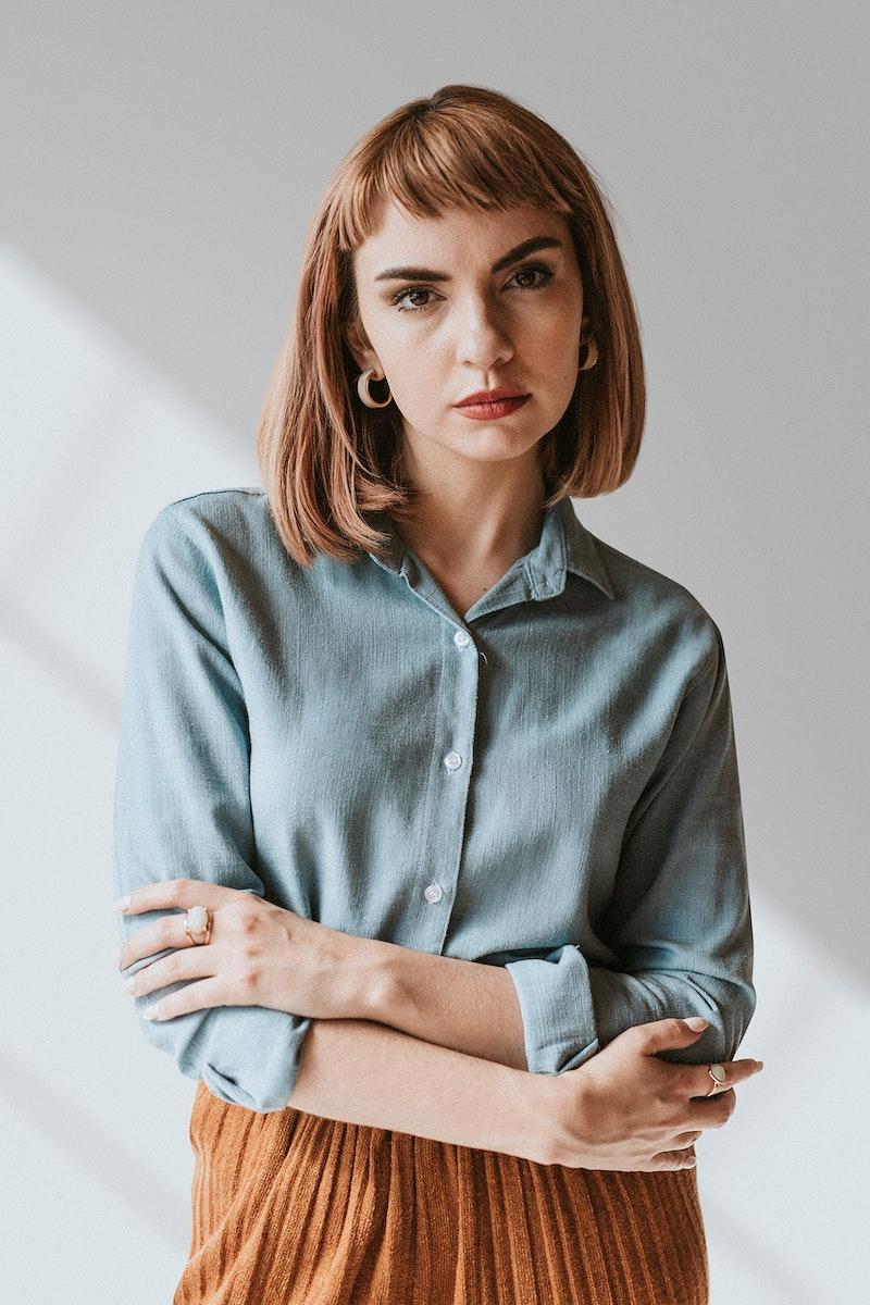 Short brown hair woman in a denim shirt