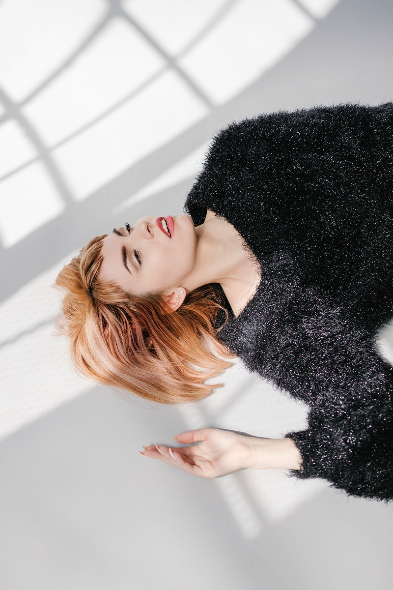Brown hair woman in a black fluffy sweater