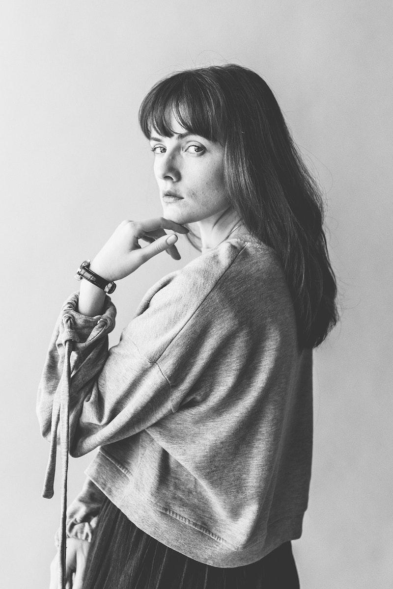 Woman in a gray long sleeve shirt