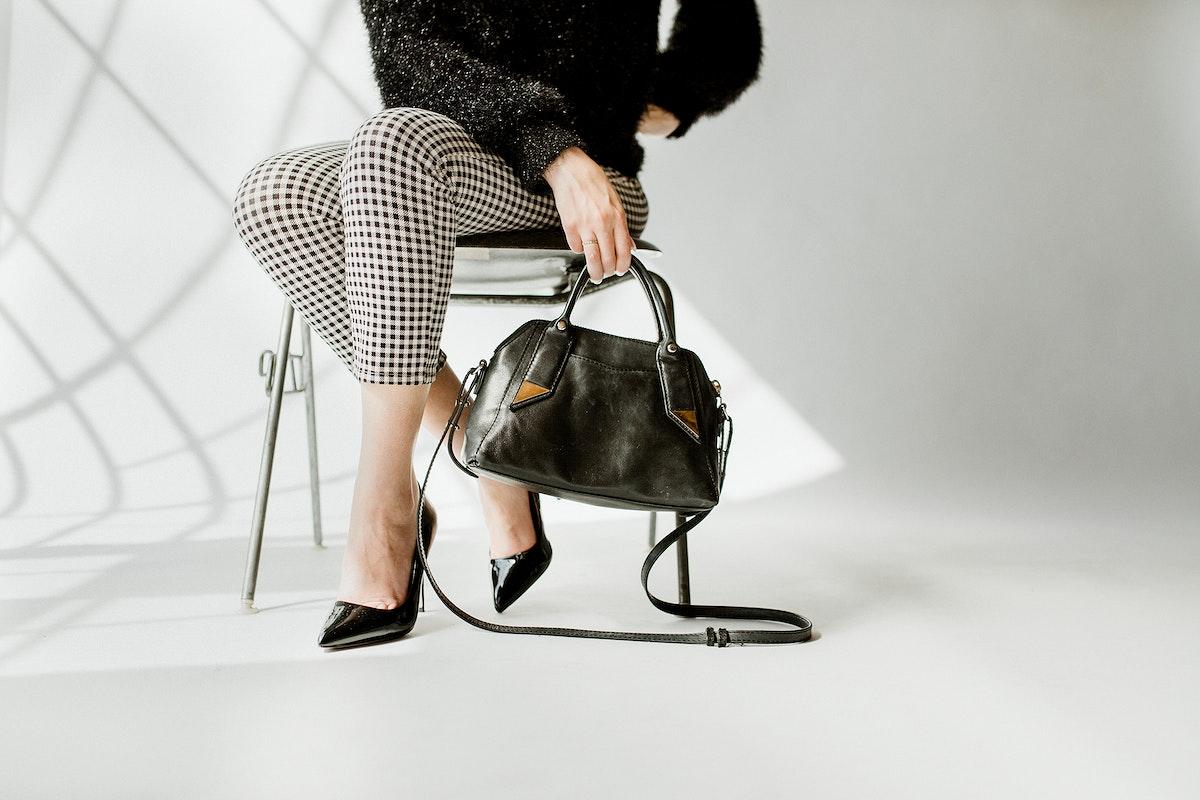 Woman carrying a black shoulder bag