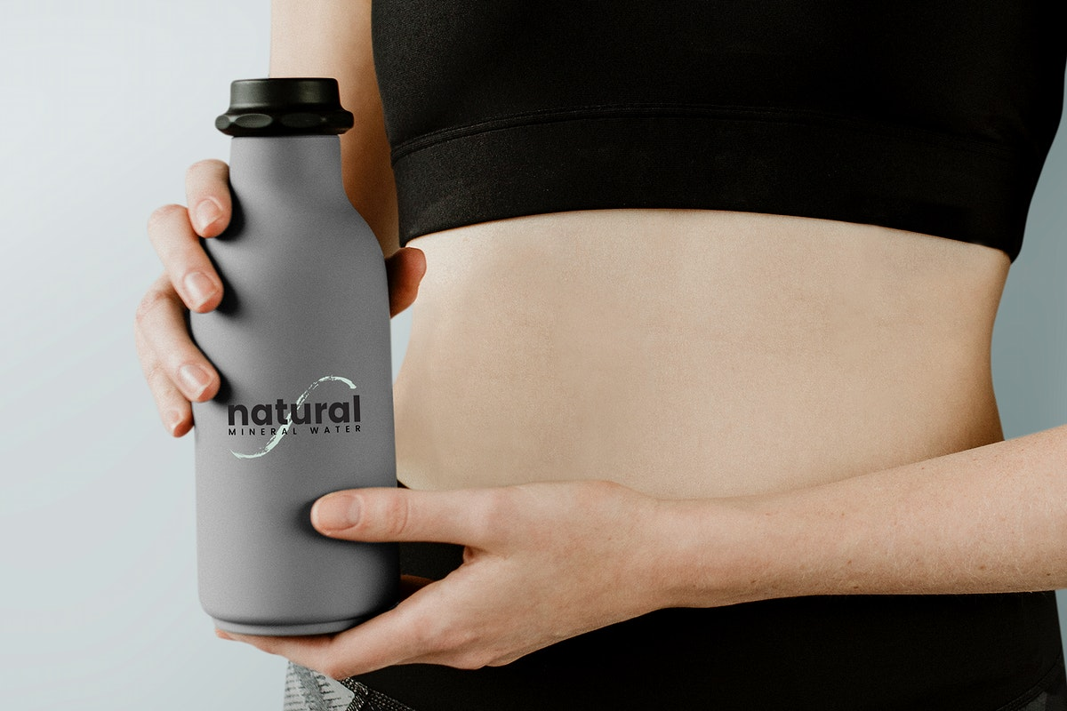 Sportive woman with a water bottle mockup
