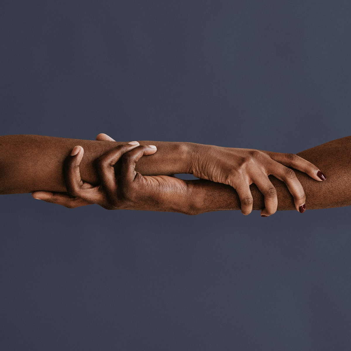 Black lovers holding each others hands