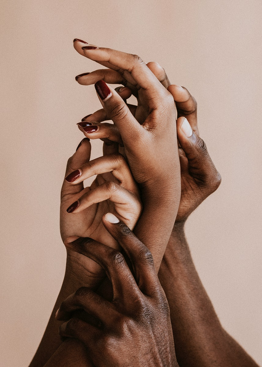 Black hands on a beige background
