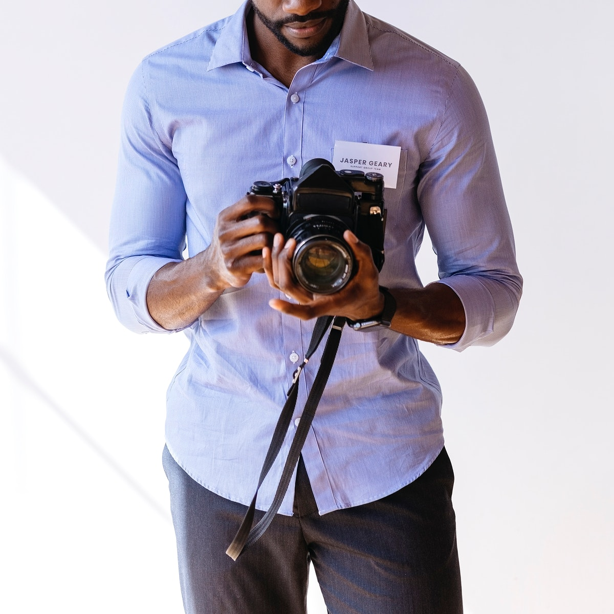Black photographer using a retro film camera social template