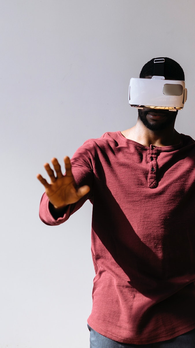 Black man experiencing virtual reality with VR headset mobile phone wallpaper