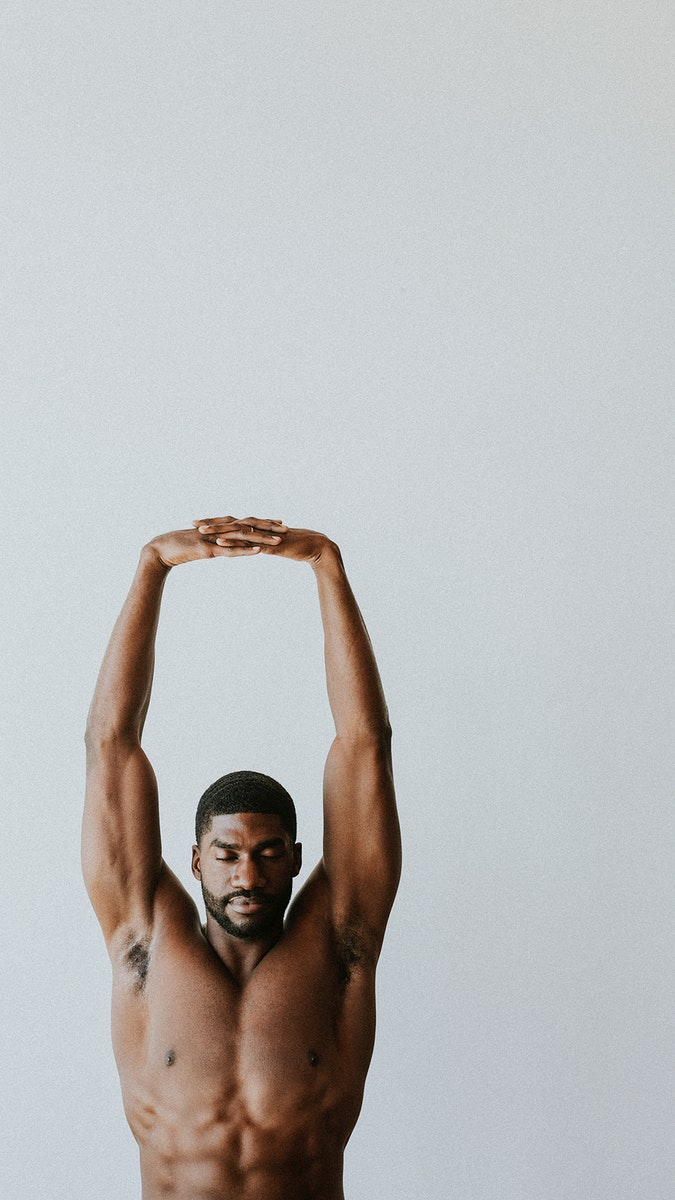 Barechested black man stretching his arms
