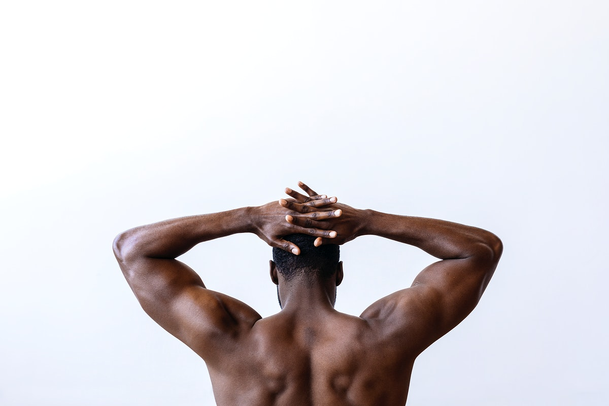 Black man stretching his back muscles