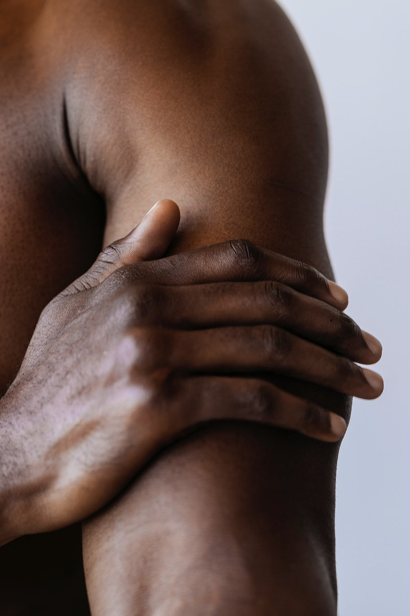 Man having a sore arm advertisement template