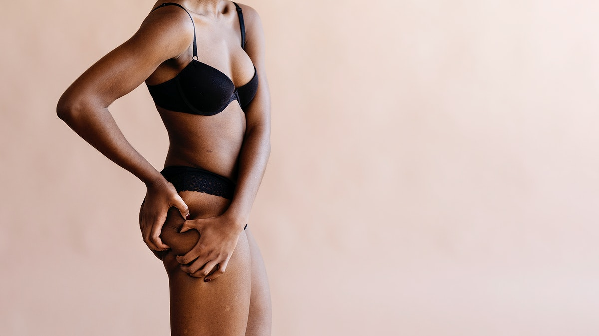 Black woman with a leg skin problem social template