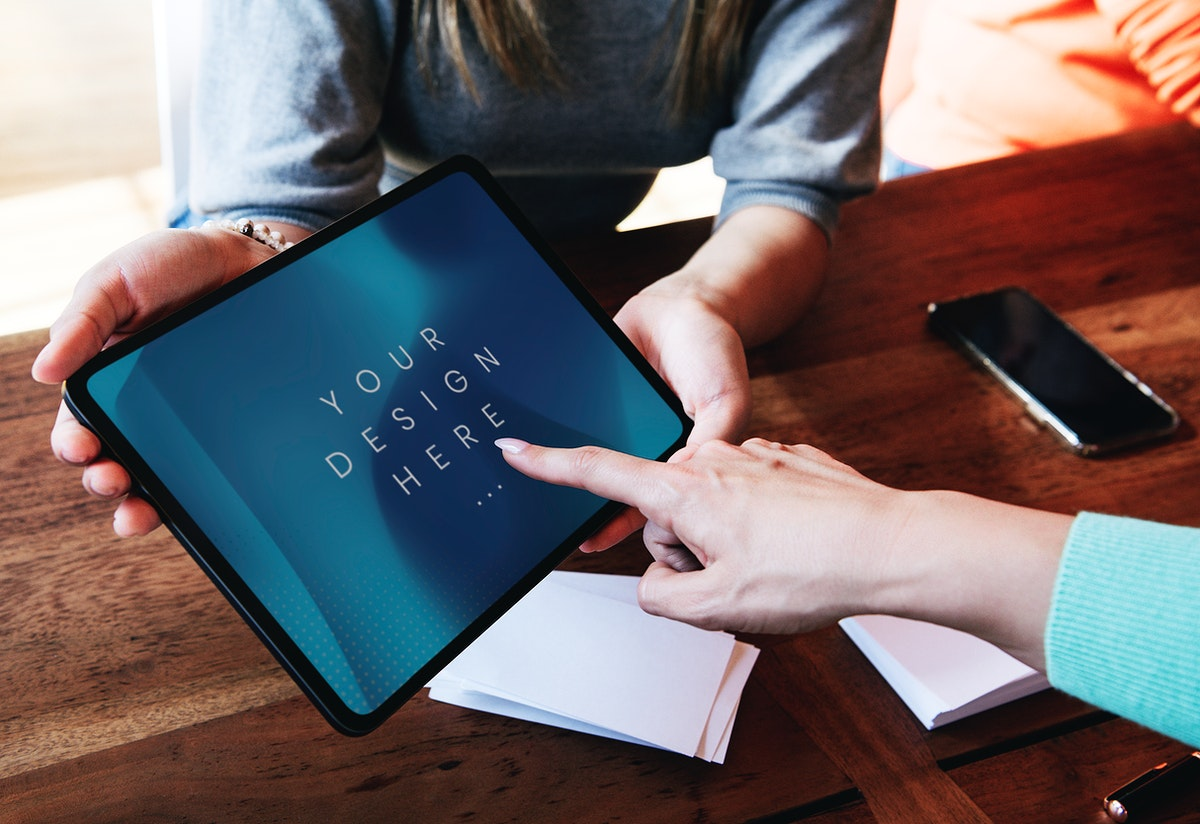 Woman pointing on a digital tablet screen mockup