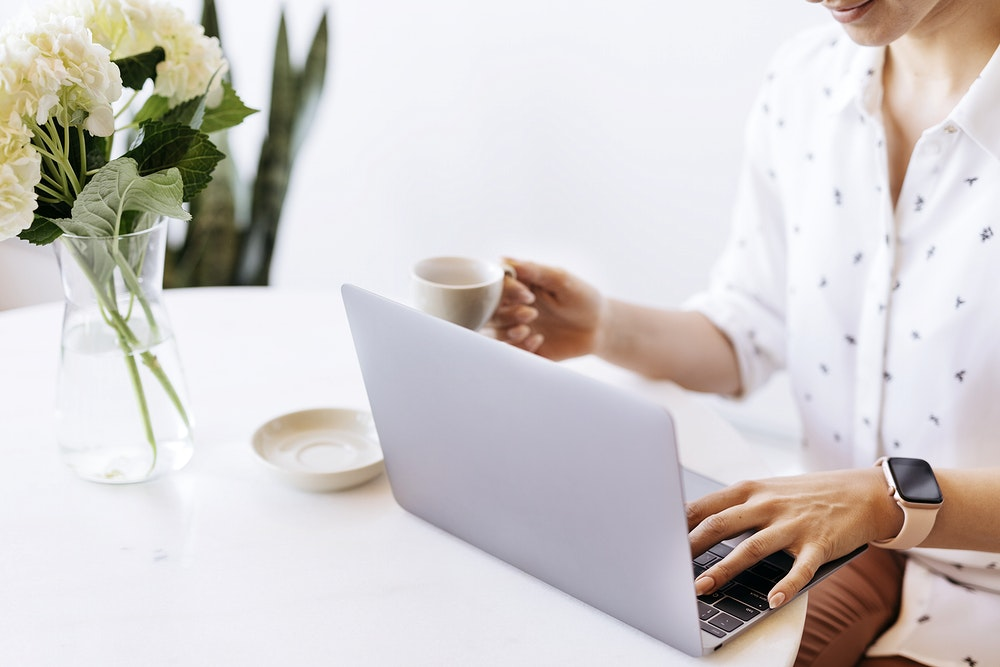 Businesswoman drinking coffee while working at home