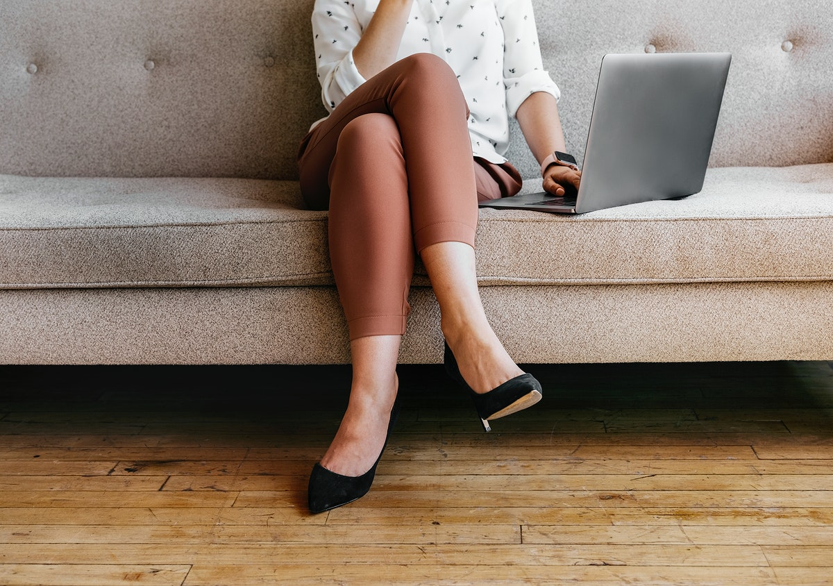 Businesswoman working at home using a laptop