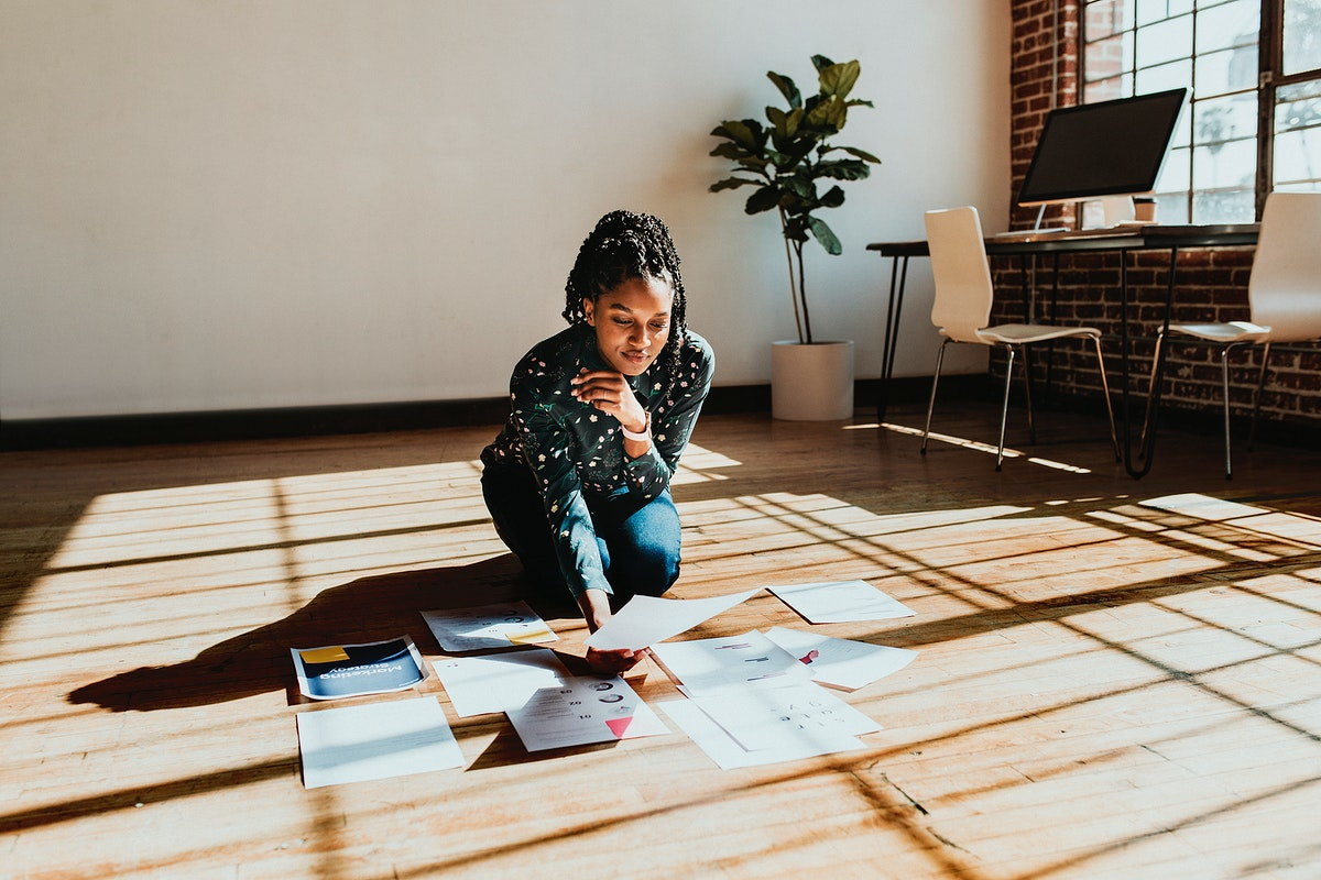 Businesswoman planning a marketing strategy on a wooden floor
