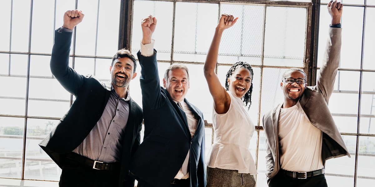 Diverse business team raising hands up in the air social banner