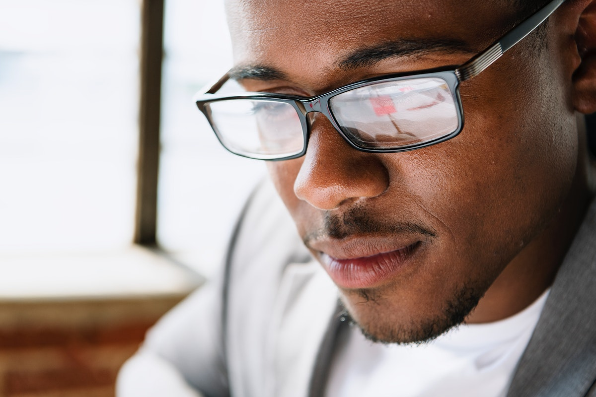 Black man in a black spectacles
