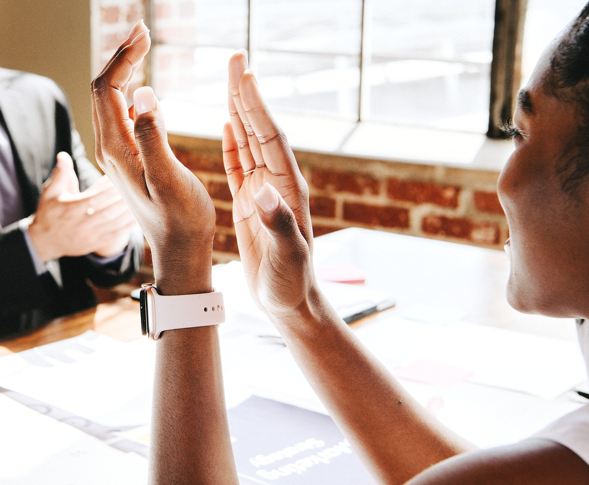 Business team clapping their hands in a meeting