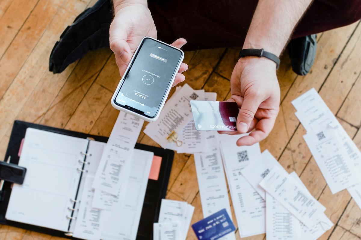 Man paying bills online via internet banking mockup