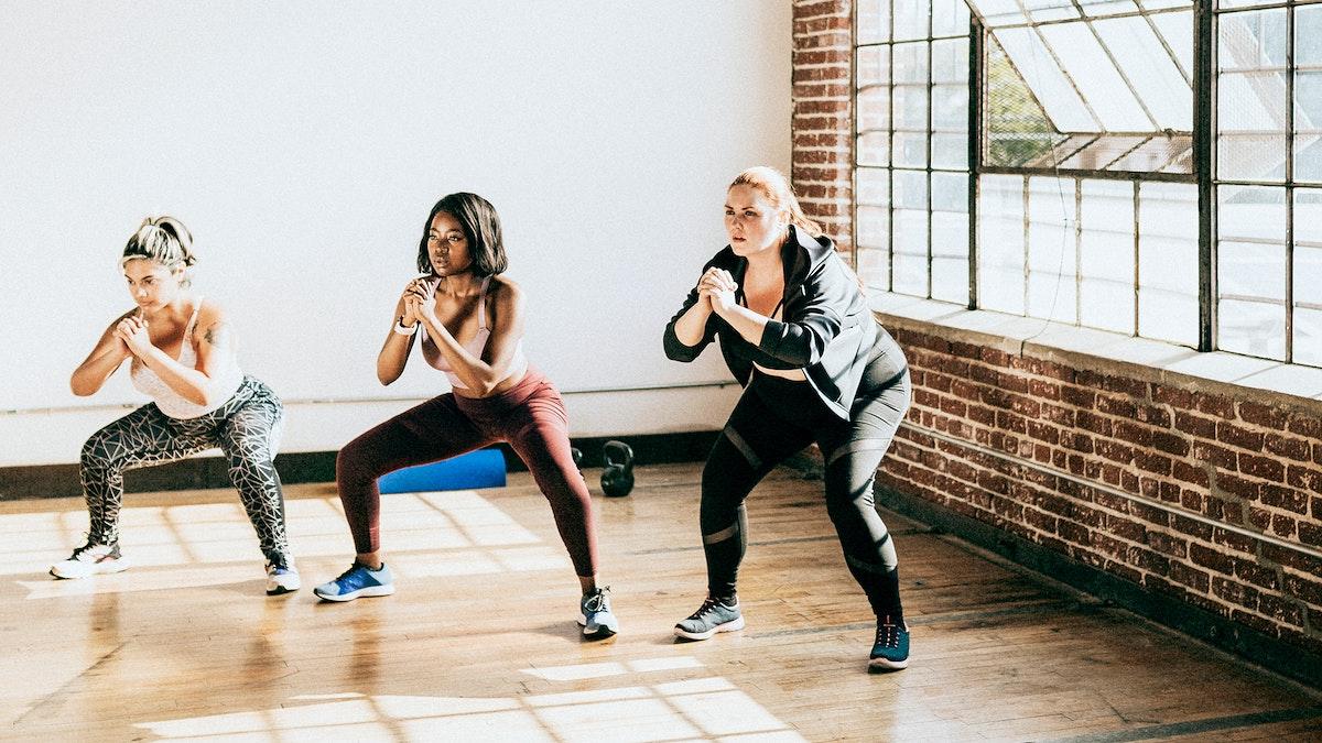 Diverse active women doing squats