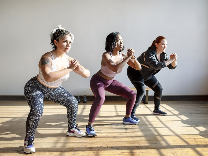 Women doing squats in fitness class