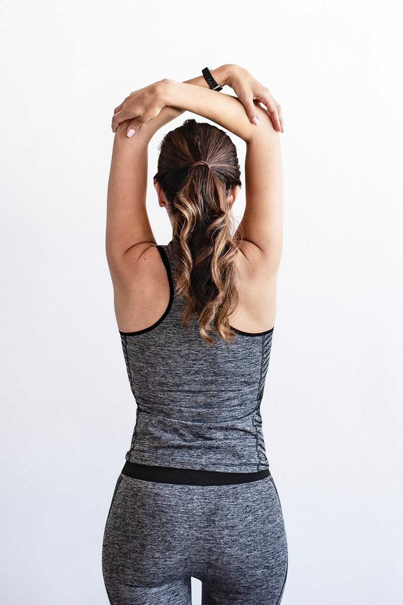 Sporty woman stretching her arms
