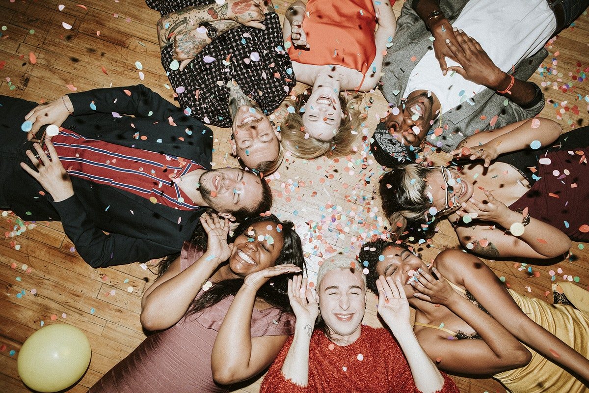 Group of friends lying on the floor at a party