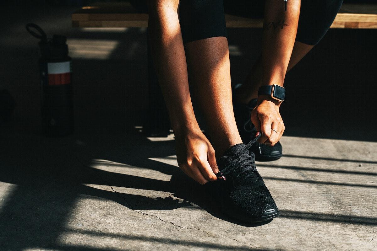 Sportive woman tying her shoelace