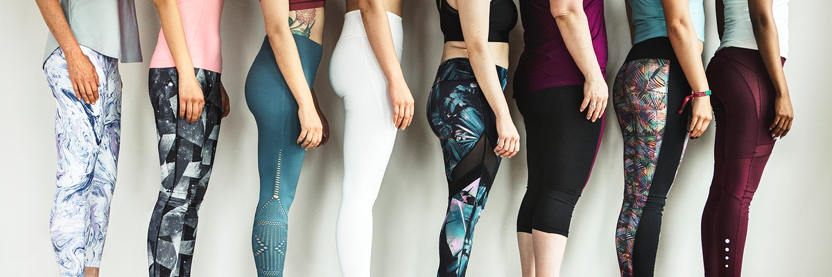 Side view of fitness women in a row