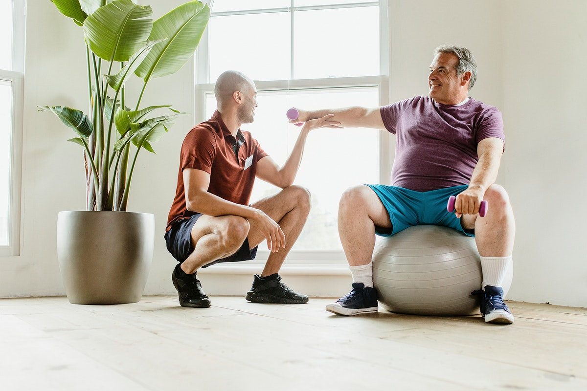 Men training in a fitness gym