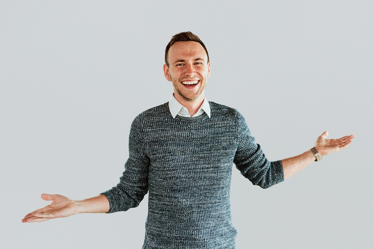 A business man smiling with arms outstretched