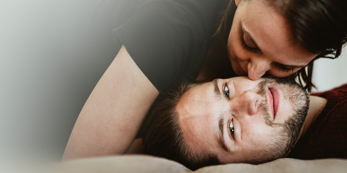 Couple kissing in the bed