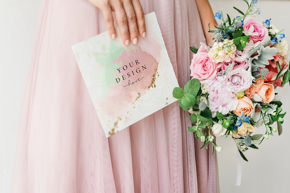 Bride holding a card mockup with a bouquet of flowers