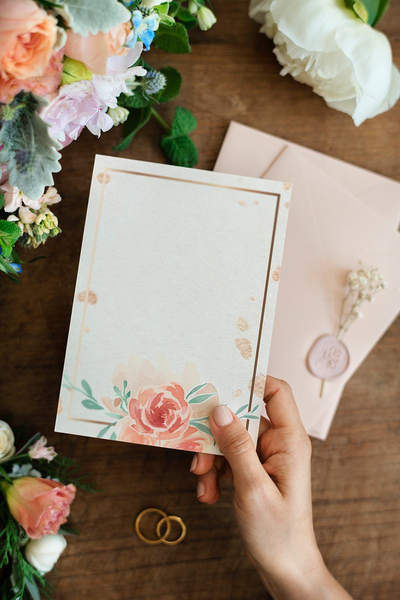 Woman holding a floral card mockup