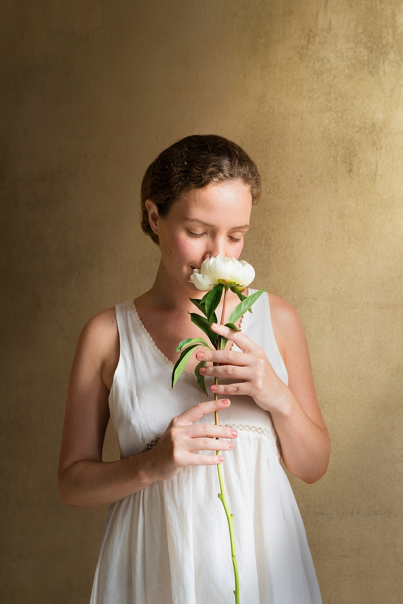 Woman with a white paeonia snowboard flower