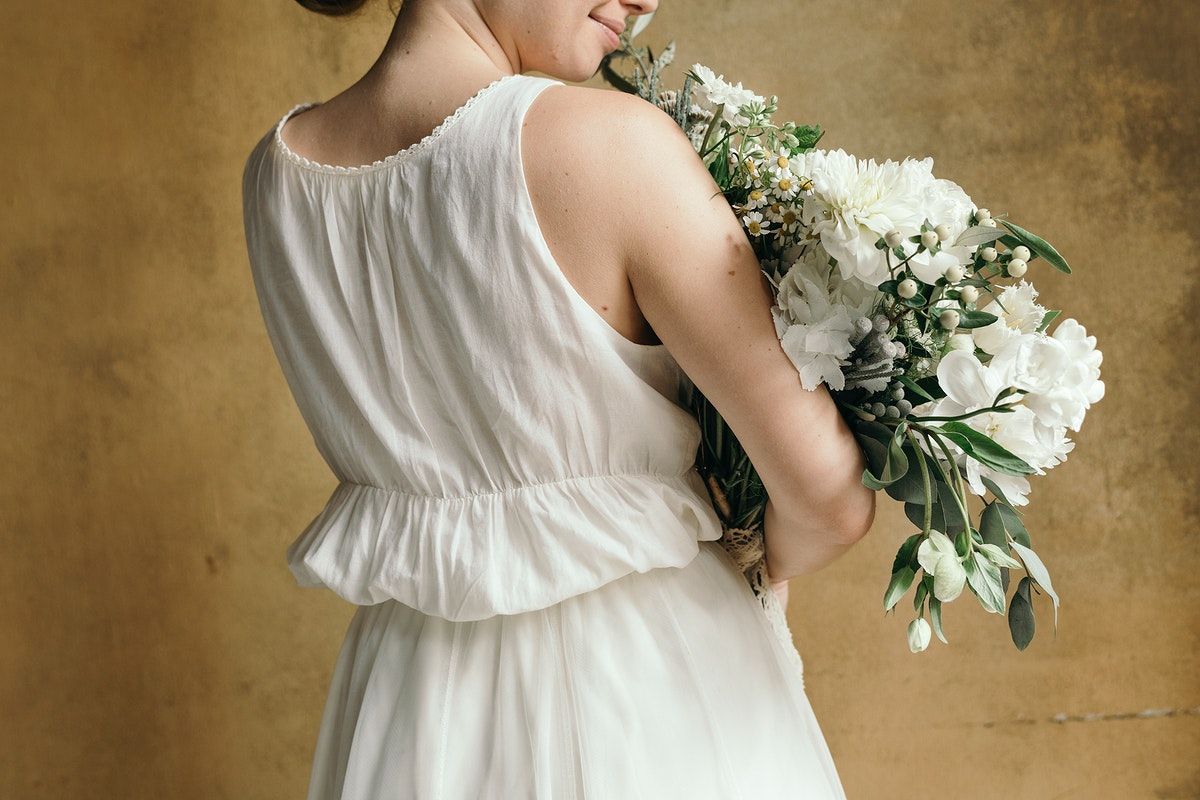 Woman holding a bouquet of white flowers