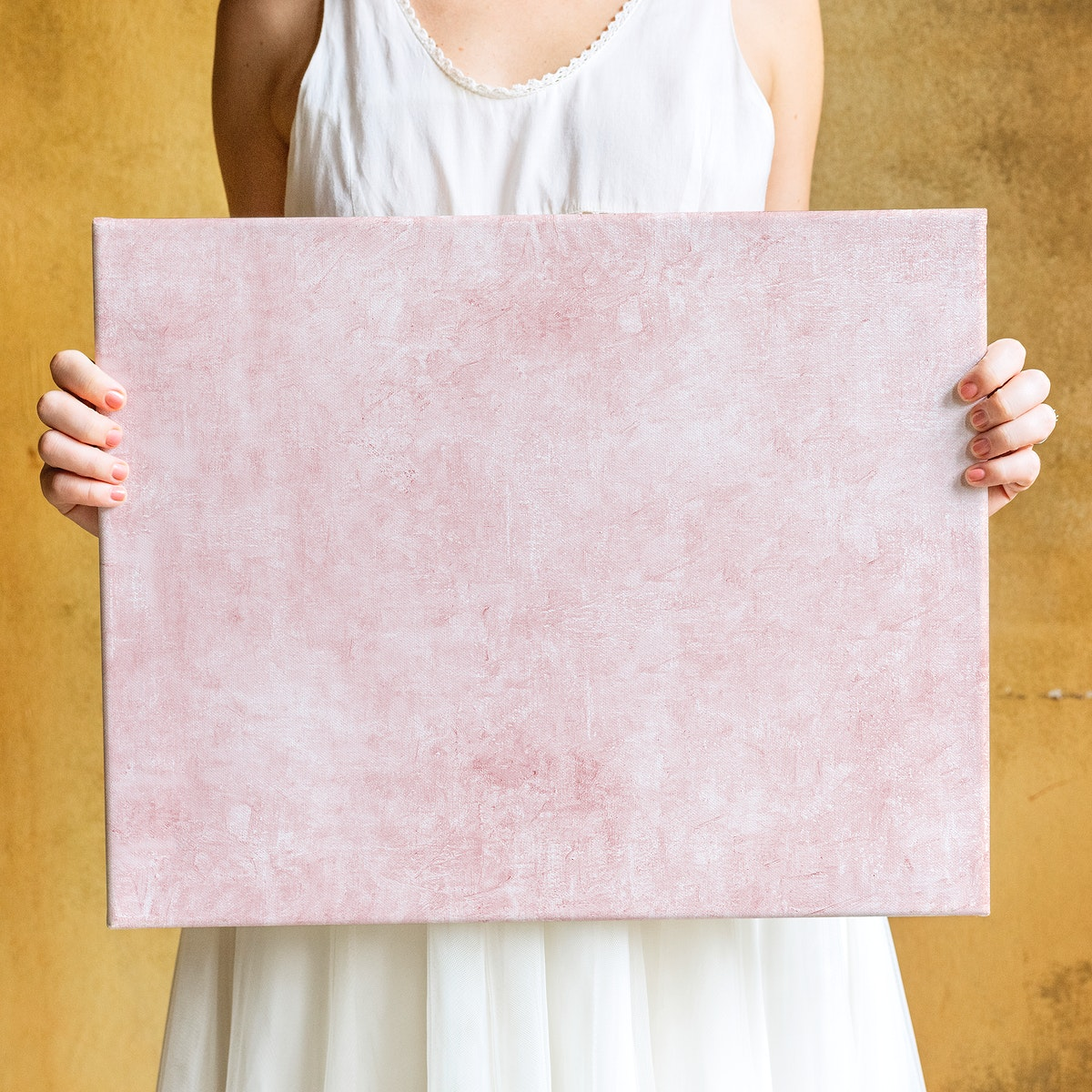 Woman showing a blank canvas mockup