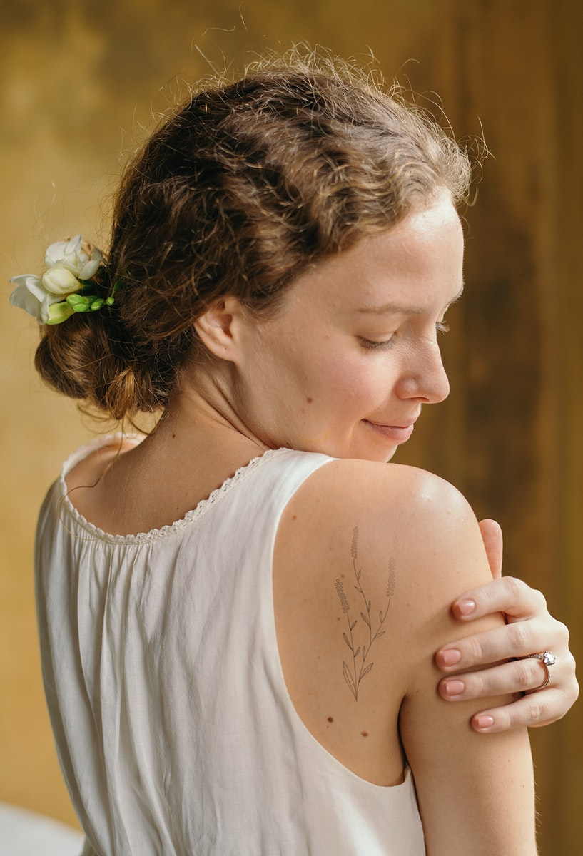 Girl with white freesia flowers in her hair