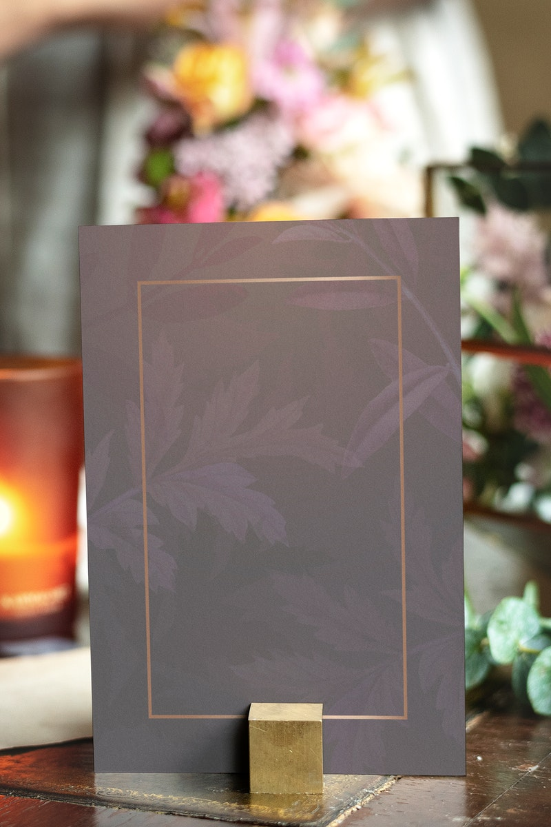 Card mockup by bouquet of flowers on a wooden table