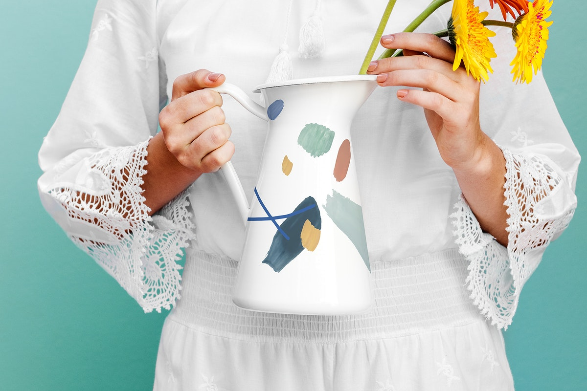 Girl holding a jug mockup with daisies