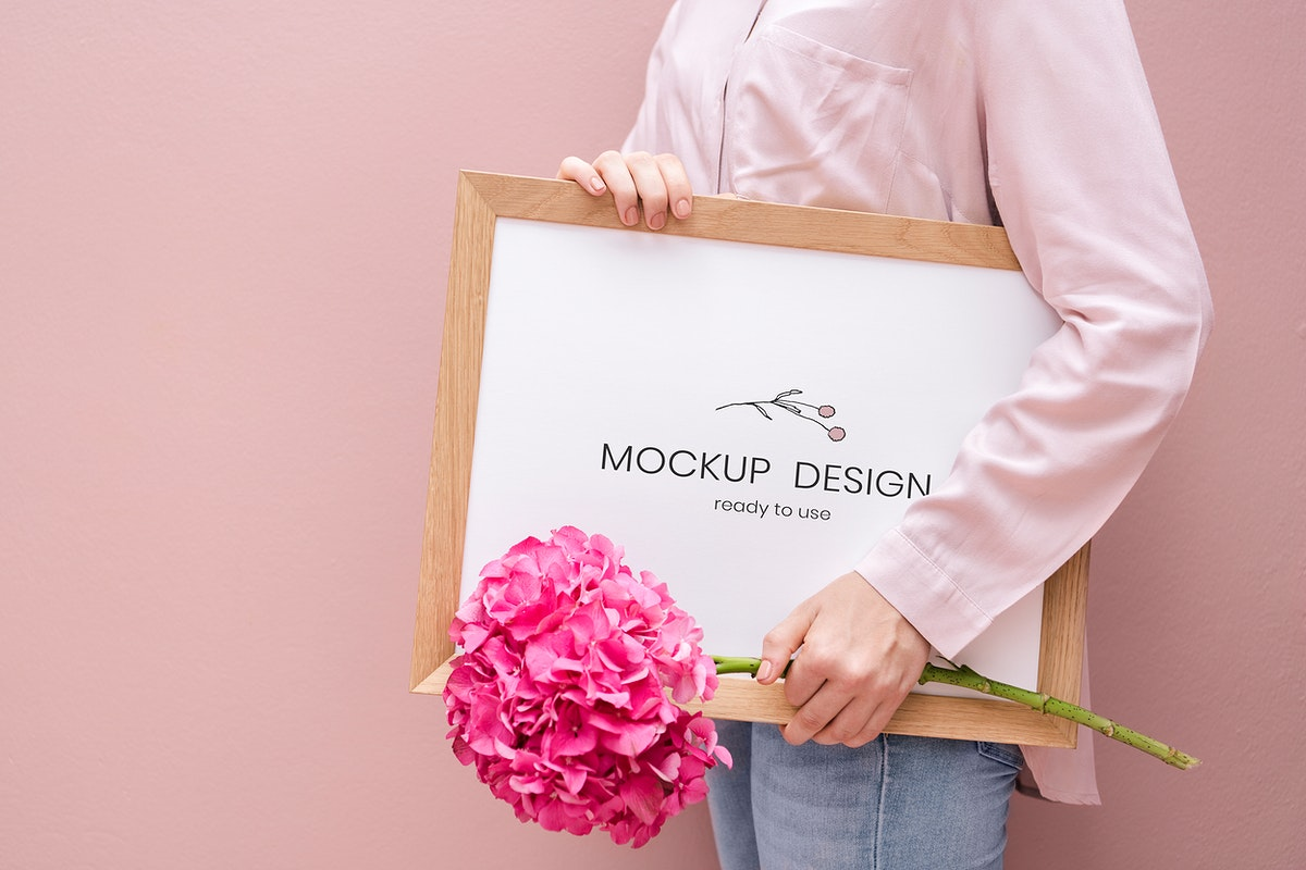 Girl holding a frame mockup with pink hydrangeas