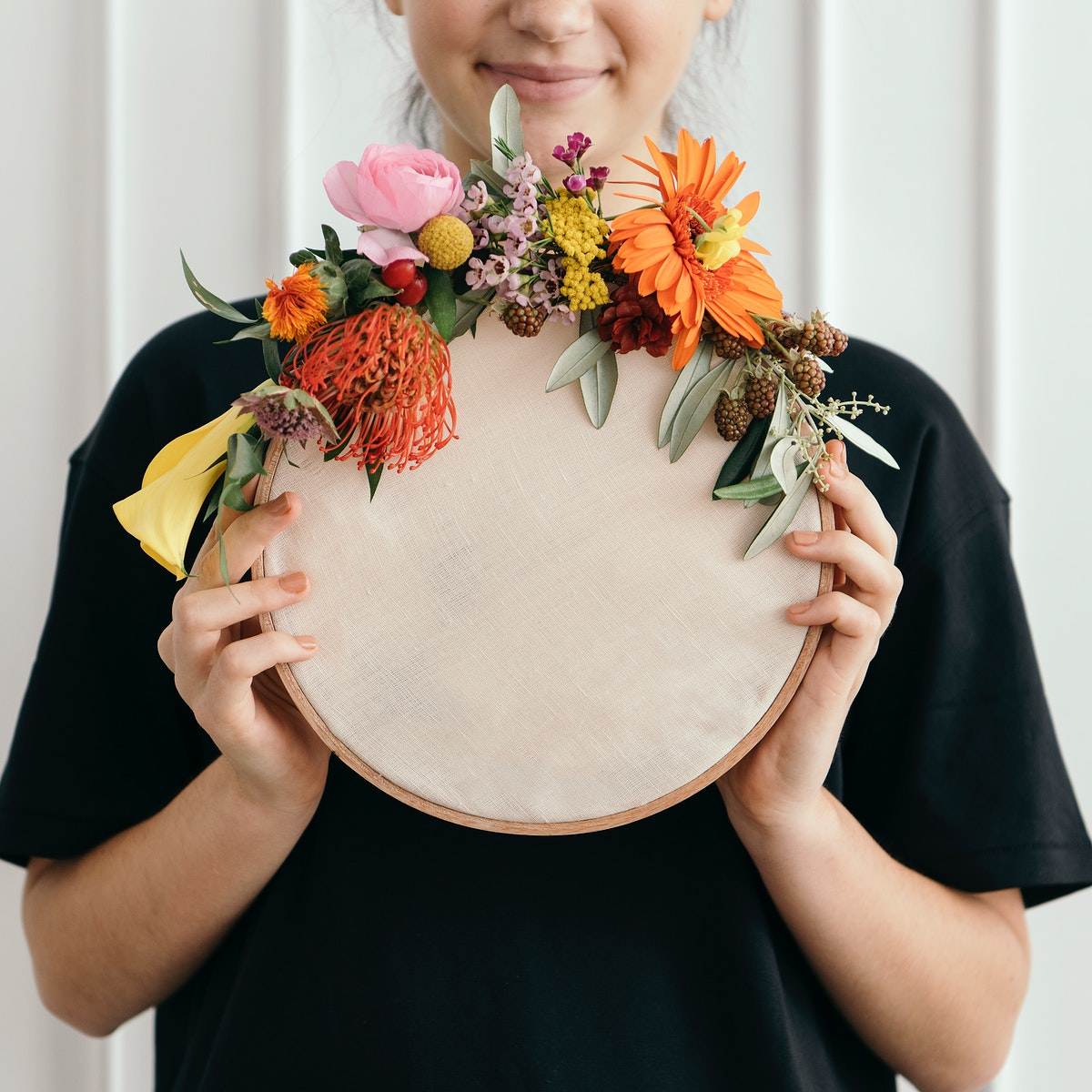 Happy woman holding a wooden frame mockup
